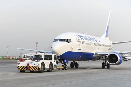 ceased: MOSCOW, RUSSIA - SEPTEMBER 26, 2014: Boeing 737 towed tractor maintenance Transaero Airlines has ceased to exist in 2015. Editorial