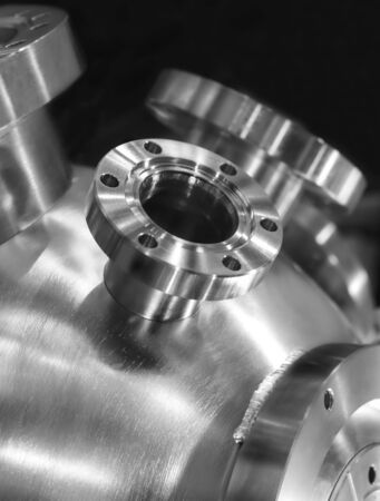 the casing: Flanged vacuum equipment. Shiny metal surface. Focus on a casing. Stock Photo