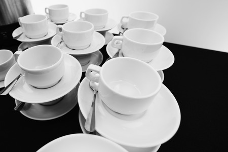 compiled: White tea cups with saucers and teaspoons compiled stack.