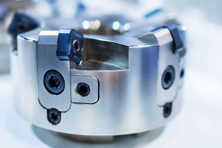 Modern milling cutter with indexable inserts. Shallow depth of field. Stock Photo