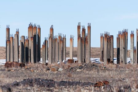 cement pole: Pile field under development on the tundra home. The pile is installed in the permafrost. Stock Photo
