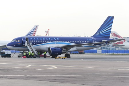 expects: MOSCOW, RUSSIA - SEPTEMBER 26, 2014:  Airbus A320 Azerbaijan Airlines on the apron of Domodedovo Airport expects passenger compartment cleaning team. Editorial