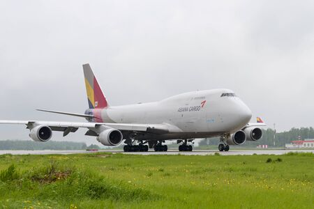 boeing 747: MOSCOW, RUSSIA - MAY 19, 2016: cargo airplane Boeing 747 Asiana Cargo taxiing to the runway at Domodedovo International airport.