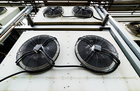 chiller: Cooling industrial air conditioning units closeup. Fans closeup. Stock Photo