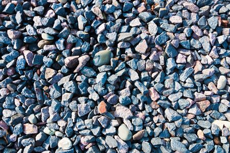 admixture: Texture colored crushed gravel with admixture of river pebbles Stock Photo
