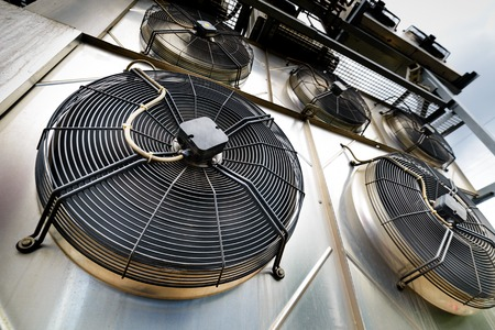 Cooling industrial air conditioning units closeup. Fans closeup. Archivio Fotografico
