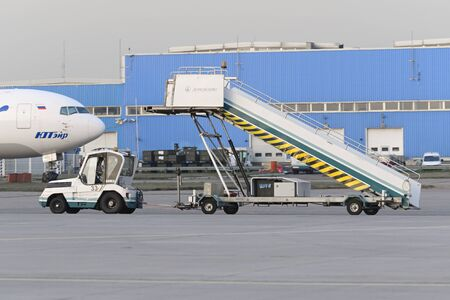 gangway: MOSCOW, RUSSIA - SEPTEMBER 26, 2014: Truck transports aircraft gangway on the platform of the international airport Domodedovo. Editorial