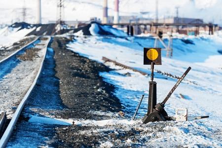 Railway points, deformation of railway track, built on permafrost. Polar tundra, Russia