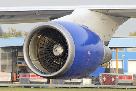 ceased: MOSCOW, RUSSIA - SEPTEMBER 26, 2014: Aircraft jet engine Boeing 747 belonging to the airline Transaero. Close-up shot.  Transaero Airlines has ceased to exist in 2015. Editorial