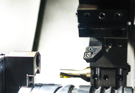 sharpening process: Cutters for metal et the CNC machine tool magazine. Metal shavings.