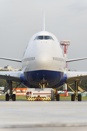 towed: MOSCOW, RUSSIA - SEPTEMBER 26, 2014: Boeing 747 Transaero towed to the runway. Transaero Airlines has ceased to exist in 2015.
