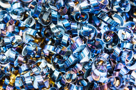 Blue metal shavings. Industrial abstract background. Shallow depth of field.