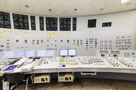 The central control room of nuclear power plant. Detail of the control panel pumping equipment. Stockfoto