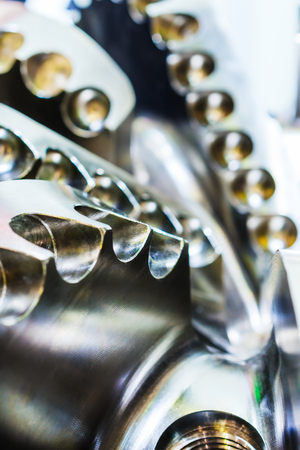 The drill bit, shot close-up with shallow depth of field. Industrial background. Stock Photo