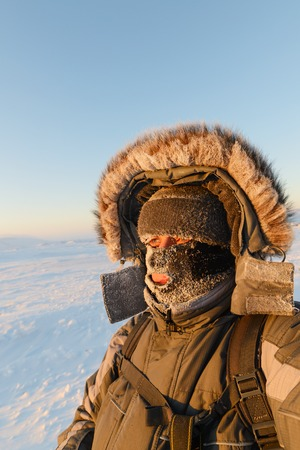 face covered: Portrait of a man with a face mask closed, his face covered with frost.