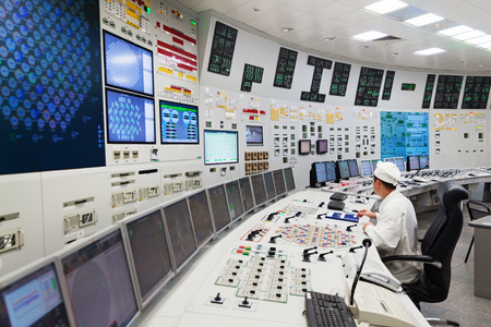 npp: KURCHATOW, RUSSIA - JUNE 23, 2016: The operator monitors the readings of devices and work equipment. Central control unit of Kursk NPP.