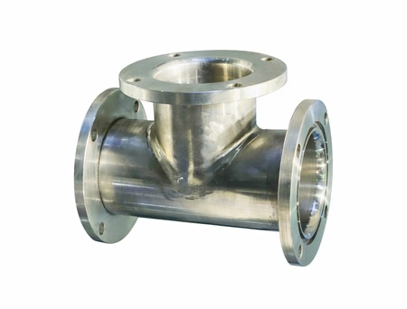 diameter: Thick stainless steel tee flanges for bolting. Isolated on white background. Stock Photo