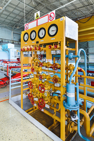 Gas distribution apparatus in the turbine room nuclear power plant. A lot of manual valves and gate valves. Stock Photo