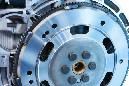 damper: Steel flywheel mounted on the engine. Abstract industrial background.