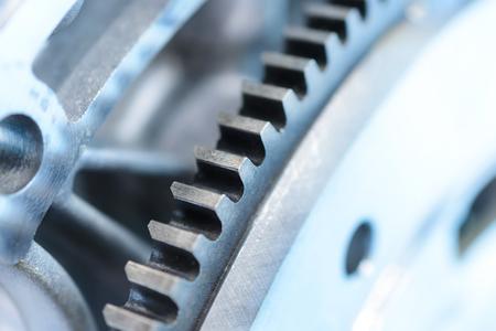 flywheel: Toothing of automotive engine flywheel. Gear closeup.