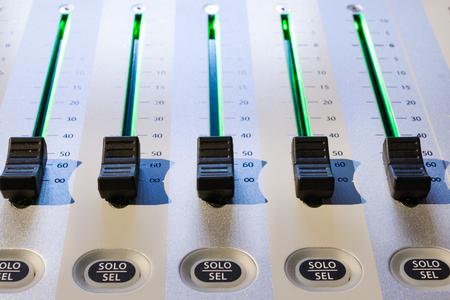 regulators: Regulators mixer close-up. Shallow depth of field. Mixing console. Sound mixer. Live and studio equipment
