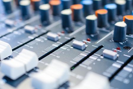 regulators: Regulators and mixer close-up controls. Shallow depth of field. Mixing console. Sound mixer. Live and studio equipment