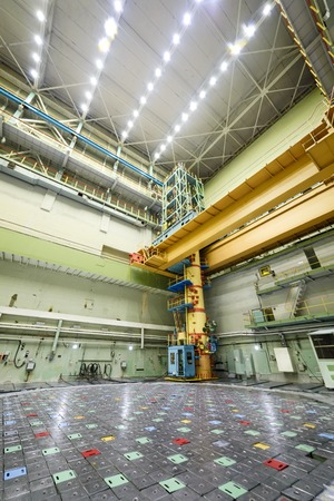 npp: Reactor room RBMK. Massive reactor lid, equipment maintenance and replacement of the reactor fuel elements. Visible charge discharge machine