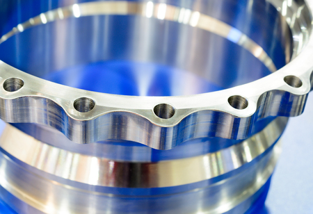 flange: Machined metal parts. Metal shiny flange, Toned in blue color Stock Photo