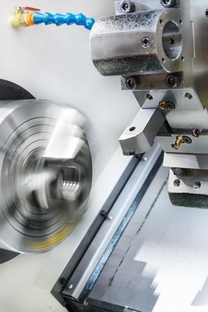 metal cutting: Rotary lathe chuck CNC metal cutting machine tool and tool holder.