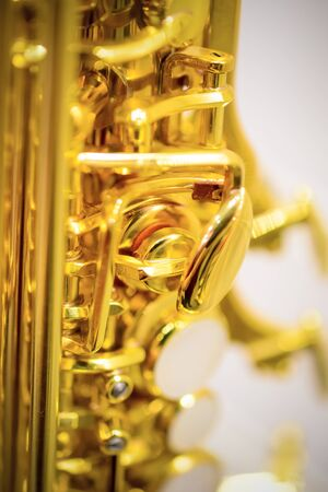 alto: Shiny golden alto saxophone with detailed view of keys