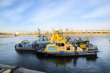 MOSCOW, RUSSIA - NOVEMBER 11, 2016: State Unitary Enterprise Mosvodostok performs recovery vessels on coastal winter parking. Ships Mosvodostok on the Moscow River. Editorial