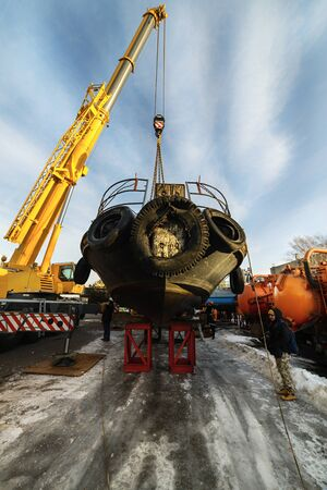 MOSCOW, RUSSIA - NOVEMBER 11, 2016: State Unitary Enterprise Mosvodostok performs recovery vessels on coastal winter parking. The ship is on the metal supports.