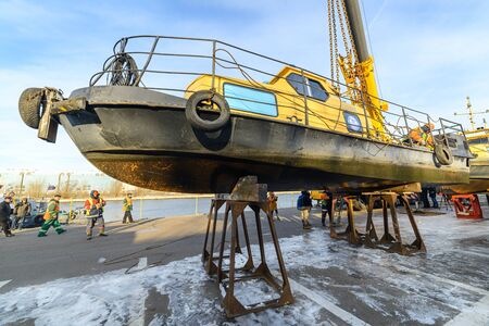 MOSCOW, RUSSIA - NOVEMBER 11, 2016: State Unitary Enterprise Mosvodostok performs recovery vessels on coastal winter parking. The boat is on the metal supports. Editorial