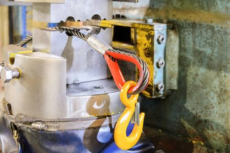 lifting hook: Steel straps with load hook. After the pressing operation. Manufacture of lifting devices. Stock Photo