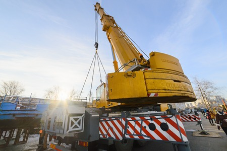 MOSCOW, RUSSIA - NOVEMBER 11, 2016: State Unitary Enterprise Mosvodostok performs recovery vessels on coastal winter parking. Car crane installed in the operating position on sliding bearings.