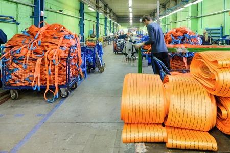 duty belt: NIZHNY NOVGOROD, RUSSIA - NOVEMBER 28, 2016: Sewing workshop for production of nylon down cargo straps. Editorial