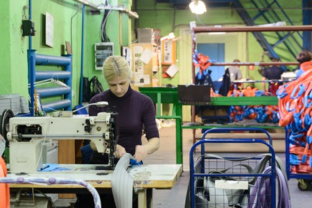 NIZHNY NOVGOROD, RUSSIA - NOVEMBER 28, 2016: Sewing workshop for production of nylon down cargo straps. Editorial
