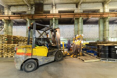 drove: Forklift drove rack with load chains. Large industrial enterprises department.