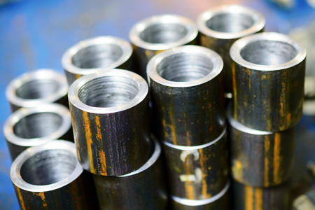 Steel sleeve. Details made lathe. Shallow depth of field. Abstract industrial background.