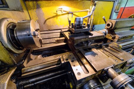 metal parts: Vintage metal cutting lathe.
