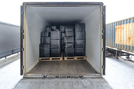 Road freight trailer loaded with boxes.