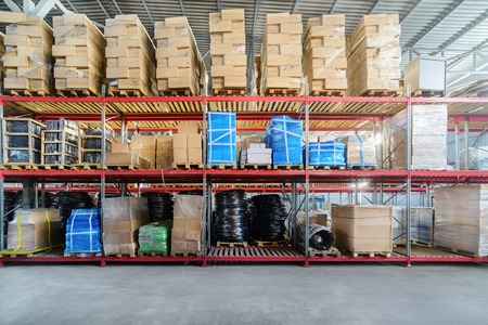 Long shelves with a variety of boxes and containers. 版權商用圖片