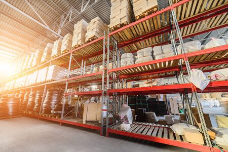 Long shelves with a variety of boxes and containers. Stock Photo