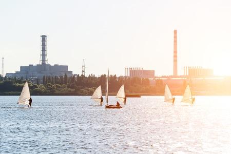 windsurfers: Windsurfers are trained on a large lake.