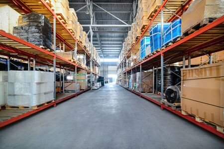 storehouse: Long shelves with a variety of boxes and containers. Stock Photo