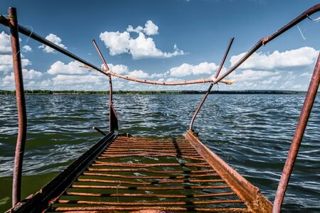 Old rusty metal bridges on the lake. Stock Photo