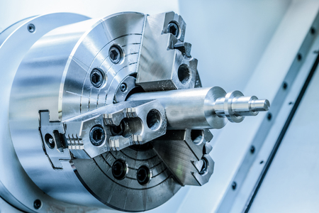 metal workpiece clamped in the lathe chuck CNC machine
