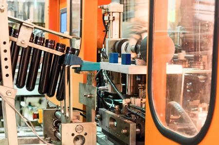 Conveyor for preforms blowing machine