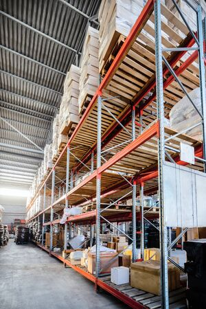 delivery room: Long shelves with a variety of boxes and containers. Stock Photo