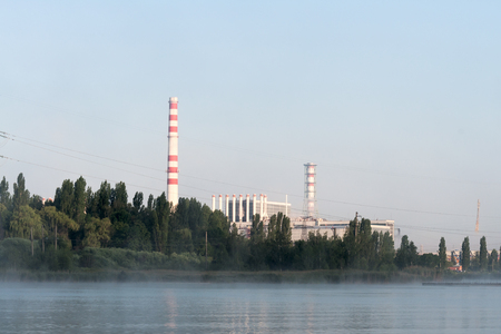 npp: Kursk Nuclear Power Plant reflected in a calm water surface.